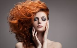 Red haired woman with blown out hair
