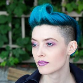 Girl with turquoise short hair